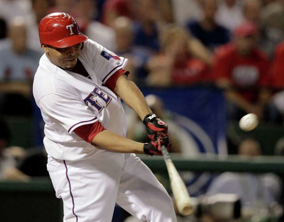 Texas Rangers' Nelson Cruz hits a double during the second inning of  Game 6 of baseball's American League championship series, against the Detroit Tigers Saturday, Oct. 15, 2011, in Arlington, Texas. (AP Photo/Charlie Riedel) Photo: Charlie Riedel