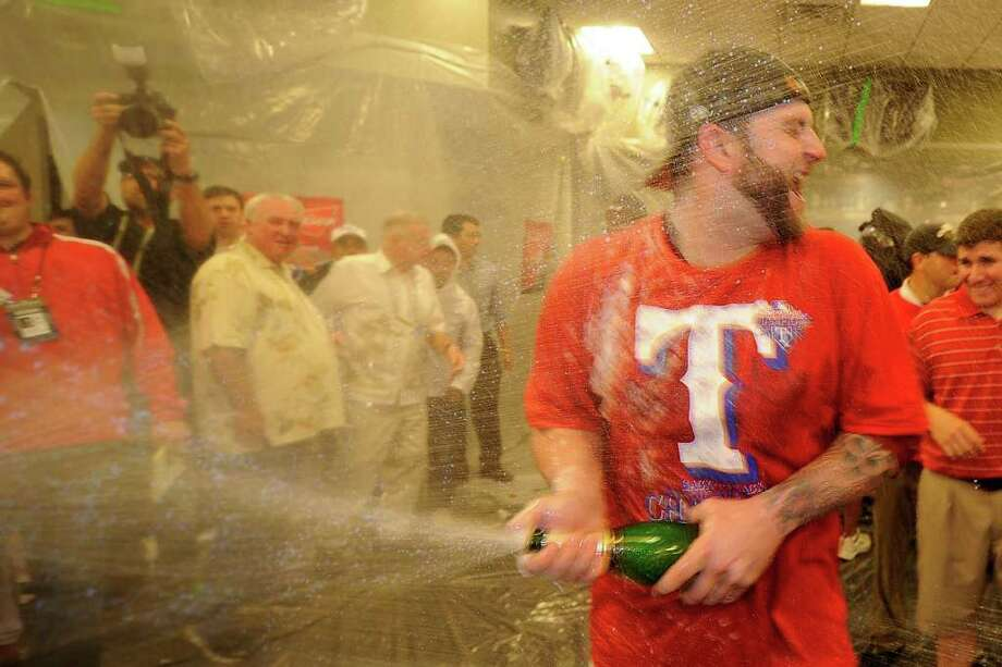 ARLINGTON, TX - OCTOBER 15:  Mike Napoli #25 of the Texas Rangers celebrates in the clubhouse after defeating the Detroit Tigers in Game Six of the American League Championship Series 15-5 to advance to the World Series at Rangers Ballpark in Arlington on October 15, 2011 in Arlington, Texas.  (Photo by Kevork Djansezian/Getty Images) Photo: Kevork Djansezian / 2011 Getty Images