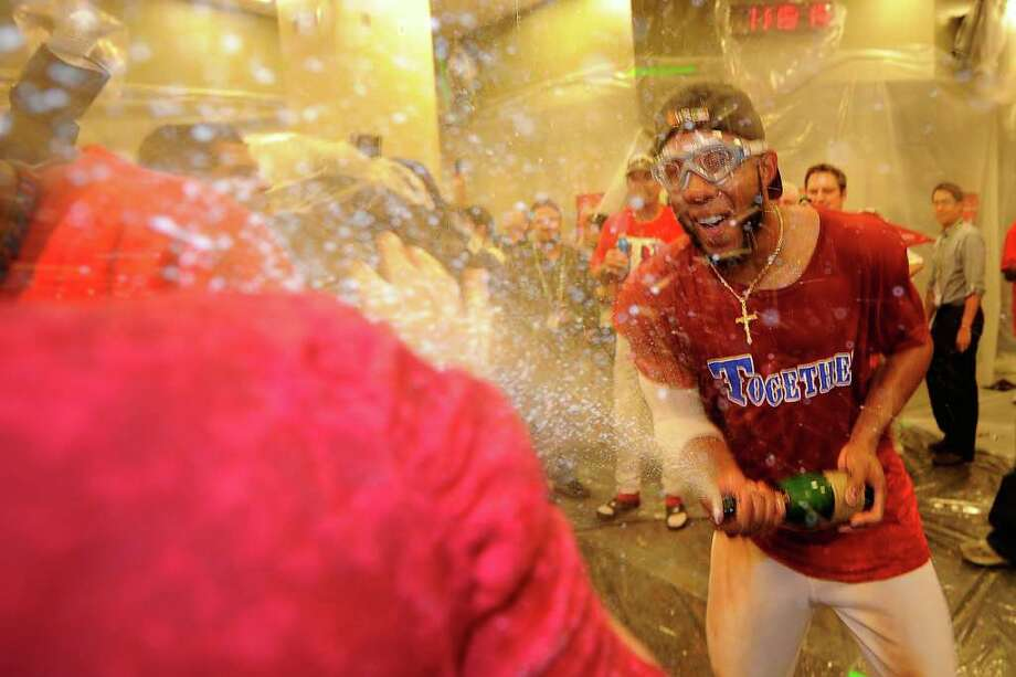 ARLINGTON, TX - OCTOBER 15:  Elvis Andrus #1 of the Texas Rangers celebrates in the clubhouse after defeating the Detroit Tigers in Game Six of the American League Championship Series 15-5 to advance to the World Series at Rangers Ballpark in Arlington on October 15, 2011 in Arlington, Texas.  (Photo by Kevork Djansezian/Getty Images) Photo: Kevork Djansezian / 2011 Getty Images