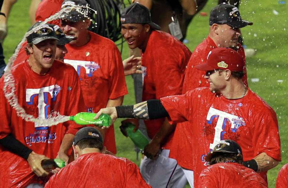 ARLINGTON, TX - OCTOBER 15:  Josh Hamilton #32 of the Texas Rangers sprays ginger ale after winning Game Six of the American League Championship Series 15-5 against the Detroit Tigers to advance to the World Series at Rangers Ballpark in Arlington on October 15, 2011 in Arlington, Texas.  (Photo by Ronald Martinez/Getty Images) Photo: Ronald Martinez / 2011 Getty Images