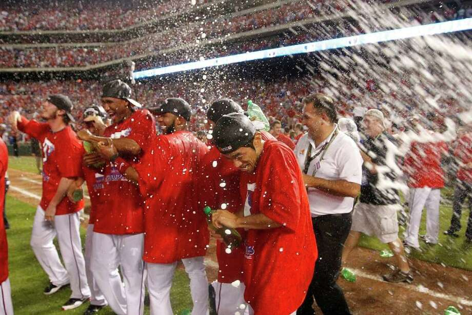 The Texas Rangers celebrate after a convincing 15-5 win over the Detroit Tigers in Game 6 of the American League Championship Series in Arlington, Texas, Saturday, October 15, 2011. The triumph returns the Rangers to the World Series for the second year in a row. (Ron T. Ennis/Fort Worth Star-Telegram/MCT) Photo: Ron T. Ennis / Fort Worth Star-Telegram