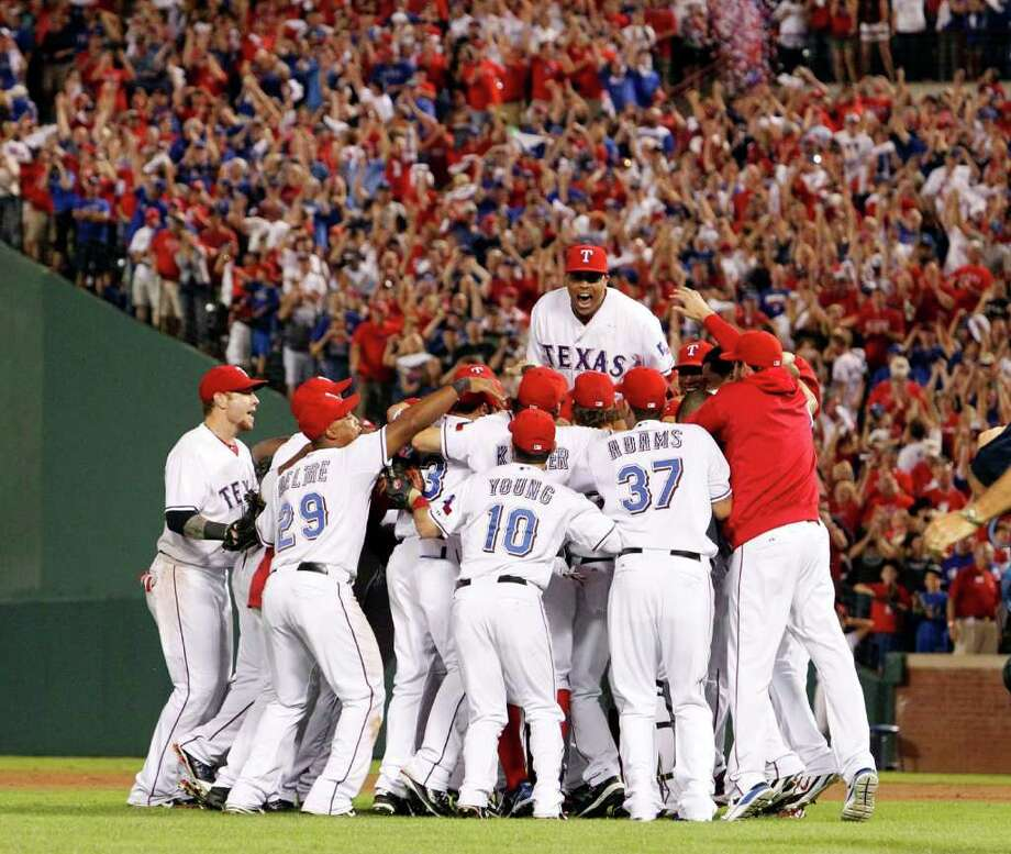 The Texas Rangers celebrate after a convincing 15-5 win over the Detroit Tigers in Game 6 of the American League Championship Series in Arlington, Texas, Saturday, October 15, 2011. The triumph returns the Rangers to the World Series for the second year in a row. (Louis DeLuca/Dallas Morning News/MCT) Photo: Louis DeLuca / Dallas Morning News