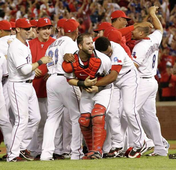 The Texas Rangers celebrate after a convincing 15-5 win over the Detroit Tigers in Game 6 of the Ame