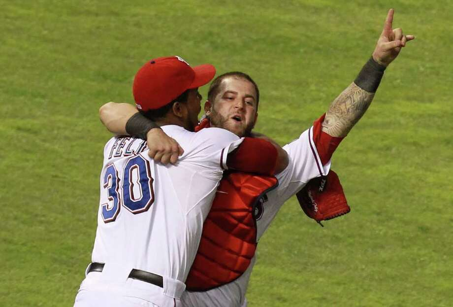 ARLINGTON, TX - OCTOBER 15:  (R-L) Mike Napoli and Neftali Feliz of the Texas Rangers celebrate winning Game Six of the American League Championship Series 15-5 against the Detroit Tigers to advance to the World Series at Rangers Ballpark in Arlington on October 15, 2011 in Arlington, Texas.  (Photo by Ronald Martinez/Getty Images) Photo: Ronald Martinez / 2011 Getty Images