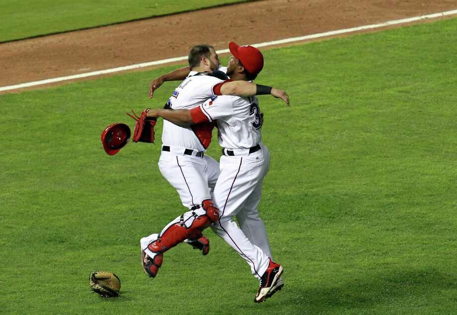 ARLINGTON, TX - OCTOBER 15:  (L-R) Mike Napoli and Neftali Feliz of the Texas Rangers celebrate winning Game Six of the American League Championship Series 15-5 against the Detroit Tigers to advance to the World Series at Rangers Ballpark in Arlington on October 15, 2011 in Arlington, Texas.  (Photo by Ronald Martinez/Getty Images) Photo: Ronald Martinez / 2011 Getty Images
