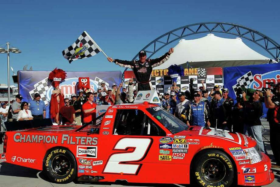 LAS VEGAS - OCTOBER 15:  Ron Hornaday, driver of the #2 Champion Chevrolet celebrates in victory lane after winning the NASCAR Camping World Truck Series Smith's 350 on October 15, 2011 at Las Vegas Motor Speedway in Las Vegas, Nevada.  (Photo by Jonathan Ferrey/Getty Images for NASCAR) Photo: Jonathan Ferrey