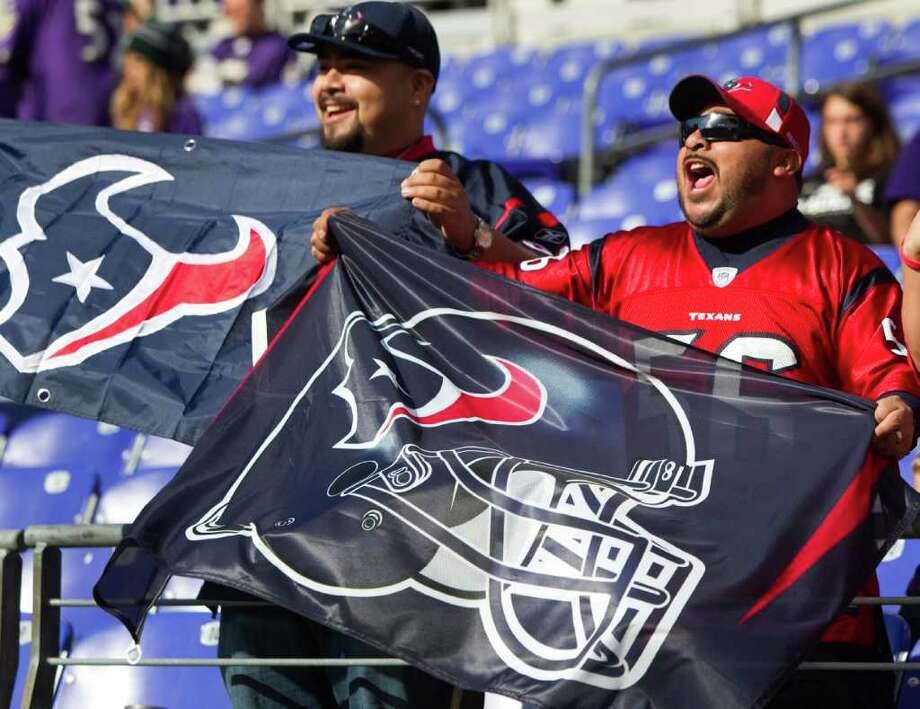 Houston Texans fans cheer on the Texans before an NFL football game against the Baltimore Ravens at M&T Bank Stadium Sunday, Oct. 16, 2011, in Baltimore. Photo: Brett Coomer, Houston Chronicle / © 2011  Houston Chronicle