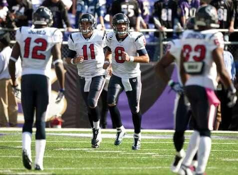 Houston Texans quarterbacks Matt Leinart (11) and Matt Schaub (8) jog onto the field before an NFL football game against the Baltimore Ravens at M&T Bank Stadium Sunday, Oct. 16, 2011, in Baltimore. Photo: Brett Coomer, Houston Chronicle / © 2011  Houston Chronicle