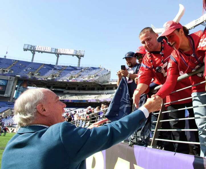 Houston Texans owner Bob McNair, left, greets a group of Texans fans before an NFL football game aga