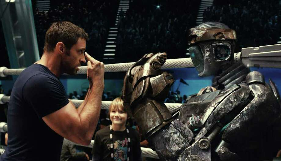 "File - This file image released by Disney/DreamWorks II shows Hugh Jackman in a scene from ""Real Steel"" the Jackman tale about machines in the boxing ring took in $16.3 million which would make it the No. 1 movie for the second straight weekend , according to studio estimates Sunday. But ""Real Steel""  came in barely ahead of the remake ""Footloose' "" which opened with $16.1 million. (AP Photo/Disney/DreamWorks II, File) Photo: Anonymous"
