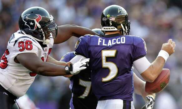 Baltimore Ravens quarterback Joe Flacco (5) fumbles as he is hit by Houston Texans defensive end Tim Jamison (96) during the second quarter of an NFL football game at M&T Bank Stadium Sunday, Oct. 16, 2011, in Baltimore. The Texans recovered the fumble. Photo: Brett Coomer, Houston Chronicle / © 2011  Houston Chronicle