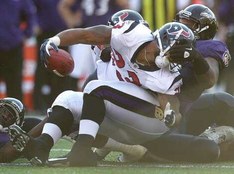 Houston Texans running back Arian Foster (23) is stopped at the line of scrimmage by Baltimore Ravens nose tackle Terrence Cody (62), stopping him short of the first down, during the second quarter of an NFL football game at M&T Bank Stadium Sunday, Oct. 16, 2011, in Baltimore. Photo: Brett Coomer, Houston Chronicle / © 2011  Houston Chronicle