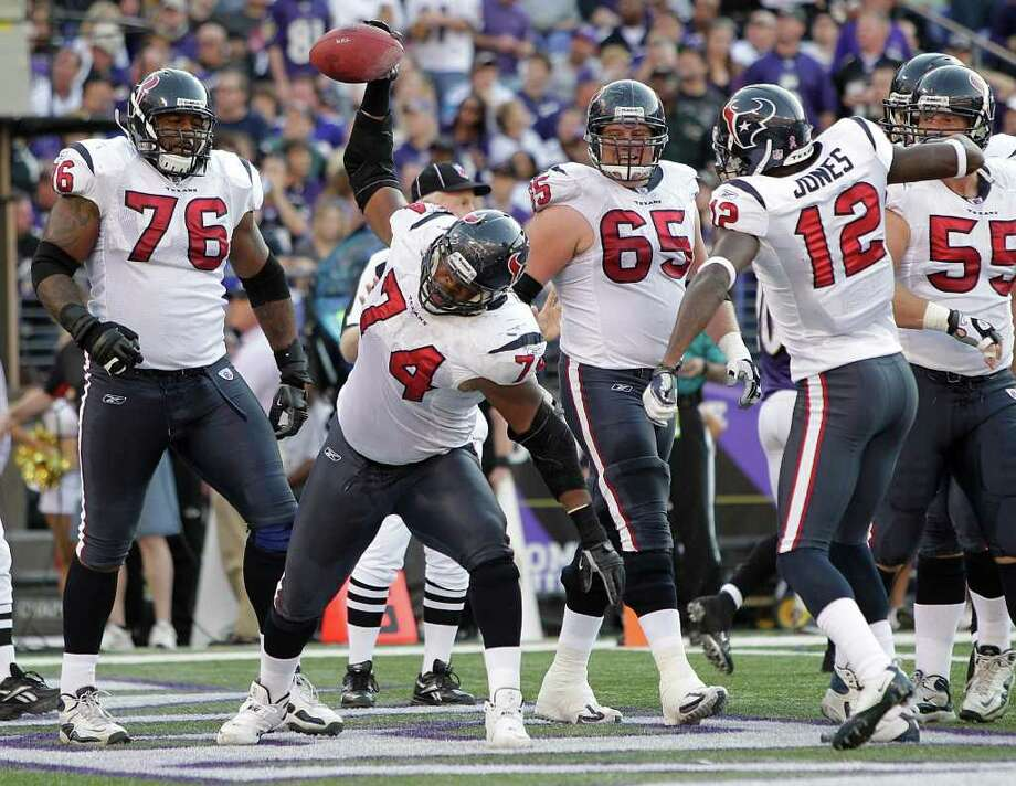 Houston Texans guard Wade Smith (74) celebrates his fumble recovery for a touchdown against the Baltimore Ravens during the second quarter of an NFL football game at M&T Bank Stadium Sunday, Oct. 16, 2011, in Baltimore. Smith recovered a Ben Tate fumble into the end zone. Photo: Brett Coomer, Houston Chronicle / © 2011  Houston Chronicle