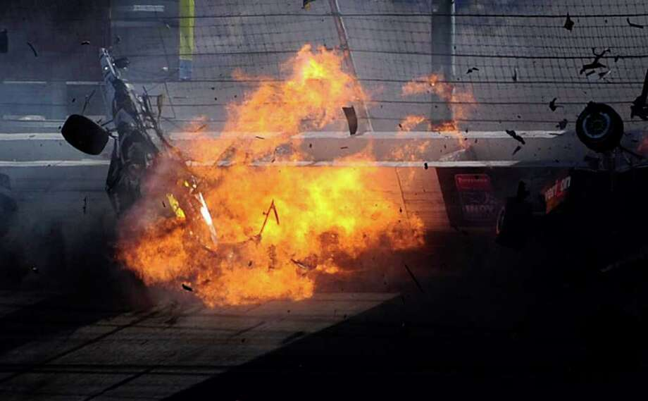 LAS VEGAS - OCTOBER 16:  The car of Dan Wheldon driver of the #77 Bowers & Wilkins Sam Schmidt Motorsports Dallara Honda (top left) bursts into flames in a 15 car pile up during the Las Vegas Indy 300 part of the IZOD IndyCar World Championships presented by Honda on October 16, 2011 at the Las Vegas Motor Speedway in Las Vegas, Nevada. Photo: Robert Laberge, Getty / 2011 Getty Images