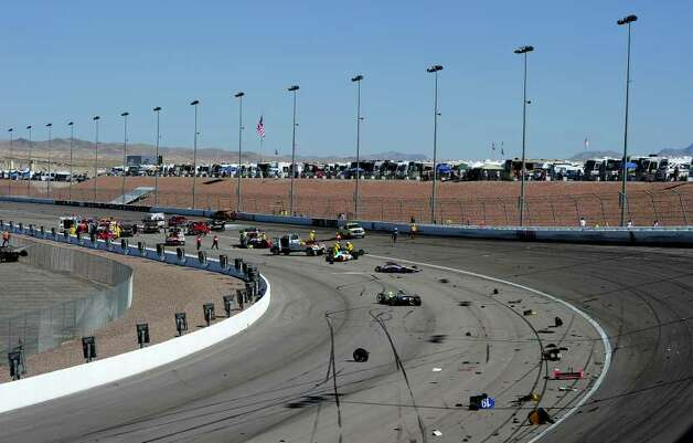 LAS VEGAS - OCTOBER 16:  Cars are scattered on the track after a 15 car crash during the Las Vegas Indy 300 part of the IZOD IndyCar World Championships presented by Honda on October 16, 2011 at the Las Vegas Motor Speedway in Las Vegas, Nevada.  (Photo by Robert Laberge/Getty Images) Photo: Robert Laberge, Getty / 2011 Getty Images