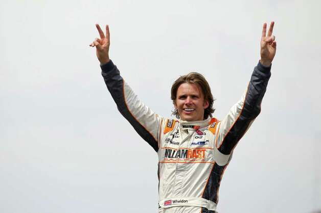 INDIANAPOLIS, IN - FILE: Dan Wheldon of England, driver of the #98 William Rast-Curb/Big Machine Dallara Honda, celebrates at the start/finish line after winning the IZOD IndyCar Series Indianapolis 500 Mile Race at Indianapolis Motor Speedway on May 29, 2011 in Indianapolis, Indiana. Wheldon died today, October 16, 2011 in Las Vegas, Nevada during the IZOD IndyCar World Championships when his car was involved in a 15-car wreck.  (Photo by Nick Laham/Getty Images) Photo: Nick Laham, Staff / 2011 Getty Images