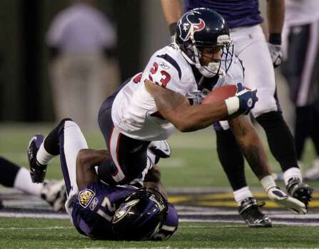 Houston Texans running back Arian Foster (23) is tackled by Baltimore Ravens cornerback Lardarius Webb (21) during the fourth quarter of an NFL football game at M&T Bank Stadium Sunday, Oct. 16, 2011, in Baltimore. Photo: Brett Coomer, Houston Chronicle / © 2011  Houston Chronicle