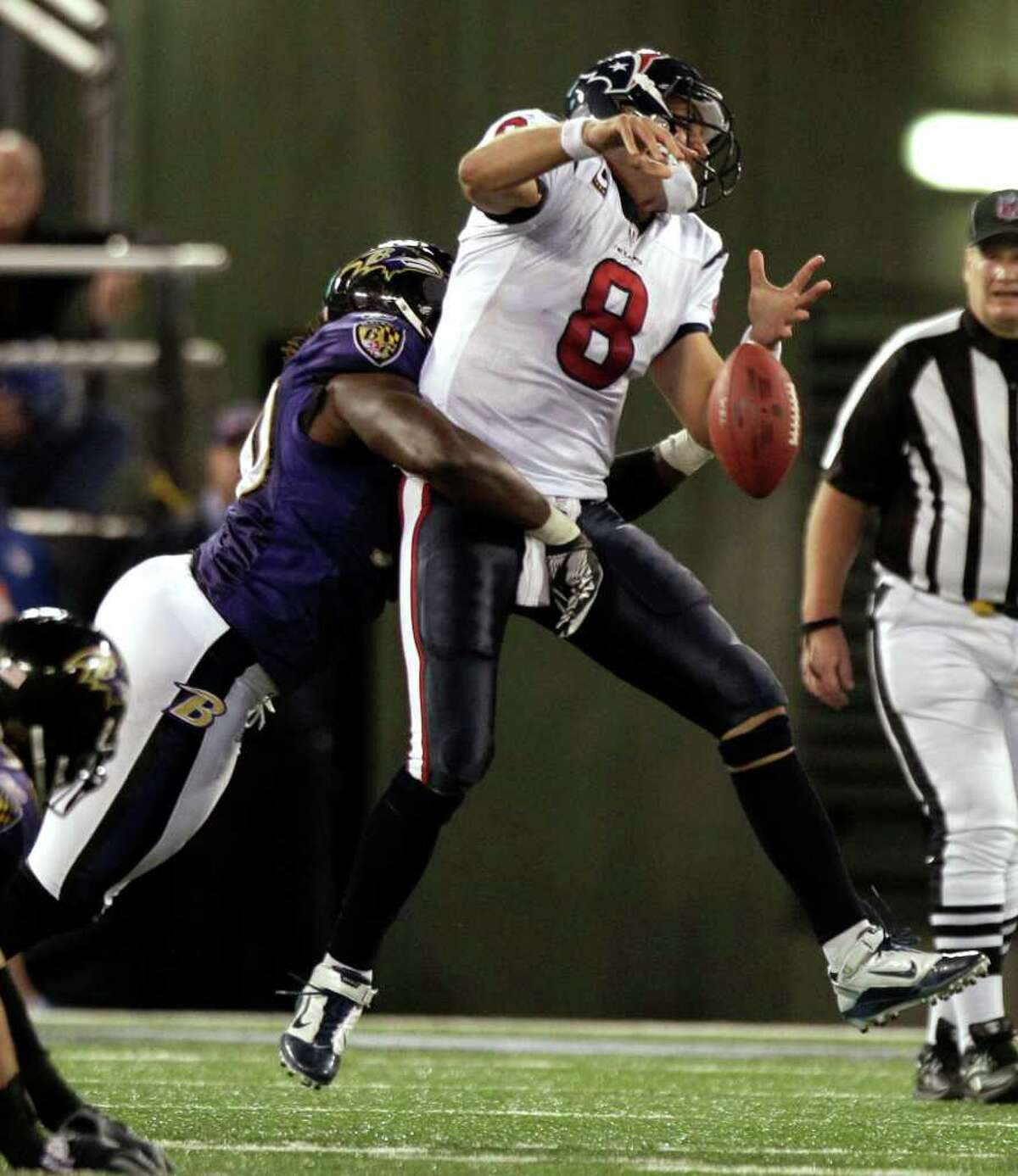 Houston Texans quarterback Matt Schaub (8) fumbles as he is hit by Baltimore Ravens defensive end Pernell McPhee (90) during the fourth quarter of an NFL football game at M&T Bank Stadium Sunday, Oct. 16, 2011, in Baltimore.