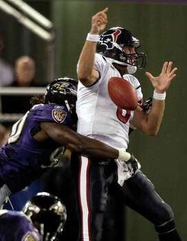 Houston Texans quarterback Matt Schaub (8) fumbles as he is hit by Baltimore Ravens defensive end Pernell McPhee (90) during the fourth quarter of an NFL football game at M&T Bank Stadium Sunday, Oct. 16, 2011, in Baltimore. Photo: Brett Coomer, Houston Chronicle / © 2011  Houston Chronicle