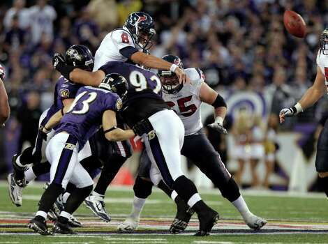 Houston Texans quarterback Matt Schaub (8) loses the football as he is hit in the chest by Baltimore Ravens defensive end Haloti Ngata (92) during the fourth quarter of an NFL football game at M&T Bank Stadium Sunday, Oct. 16, 2011, in Baltimore. Photo: Brett Coomer, Houston Chronicle / © 2011  Houston Chronicle