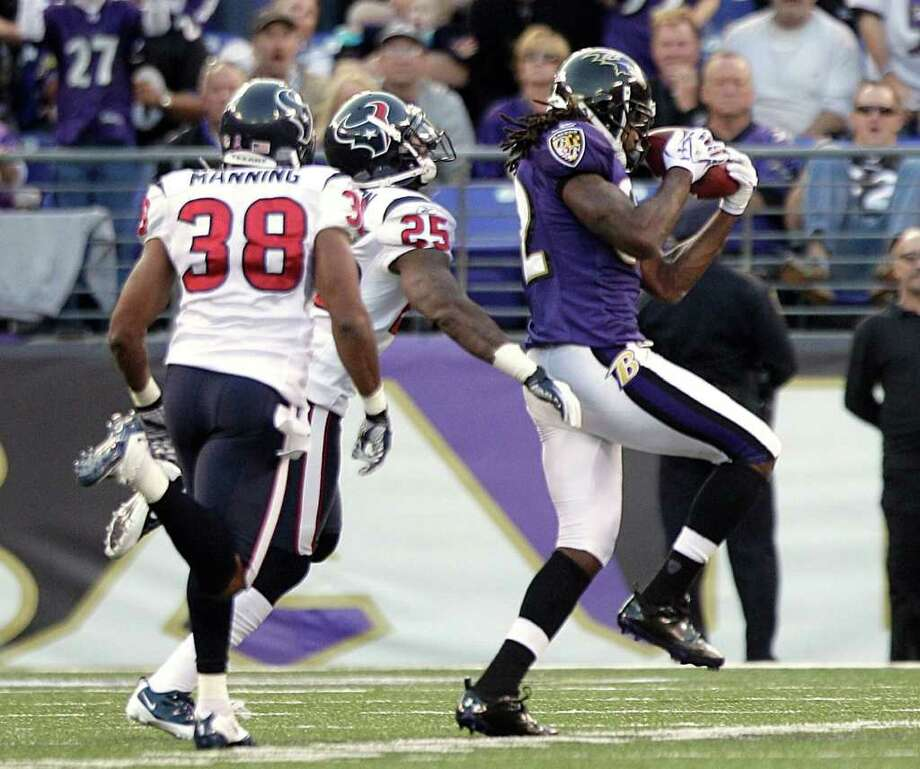 Baltimore Ravens wide receiver Torrey Smith (82) beats Houston Texans cornerback Kareem Jackson (25) and safety Danieal Manning (38) for a 51-yard reception during the third quarter of an NFL football game at M&T Bank Stadium Sunday, Oct. 16, 2011, in Baltimore. The Ravens beat the Texans 29-14. Photo: Brett Coomer, Houston Chronicle / © 2011  Houston Chronicle