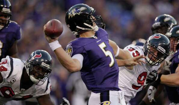 Baltimore Ravens quarterback Joe Flacco (5) throws a pass as he is pressured by Houston Texans defensive end Antonio Smith (94) and Texans defensive end J.J. Watt (99) during the third quarter of an NFL football game at M&T Bank Stadium Sunday, Oct. 16, 2011, in Baltimore. The Ravens beat the Texans 29-14. Photo: Brett Coomer, Houston Chronicle / © 2011  Houston Chronicle