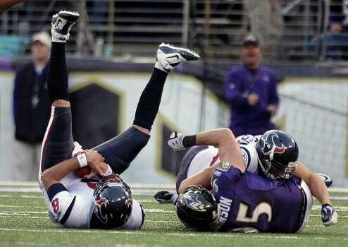 Houston Texans quarterback Matt Schaub (8) is sacked by Baltimore Ravens outside linebacker Jarret Johnson (95) during the third quarter of an NFL football game at M&T Bank Stadium Sunday, Oct. 16, 2011, in Baltimore. The Ravens beat the Texans 29-14. Photo: Brett Coomer, Houston Chronicle / © 2011  Houston Chronicle