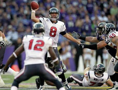 Houston Texans quarterback Matt Schaub (8) gets off a pass as he is pressured by Baltimore Ravens outside linebacker Terrell Suggs (55) and Baltimore Ravens defensive end Haloti Ngata, right, during the third quarter of an NFL football game at M&T Bank Stadium Sunday, Oct. 16, 2011, in Baltimore. Photo: Brett Coomer, Houston Chronicle / © 2011  Houston Chronicle
