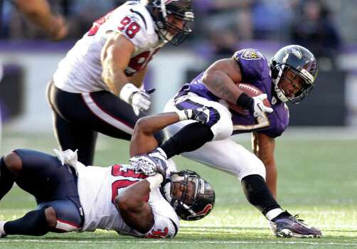 Baltimore Ravens running back Ray Rice (27) is tripped up Houston Texans cornerback Jason Allen (30) during the second quarter of an NFL football game at M&T Bank Stadium Sunday, Oct. 16, 2011, in Baltimore. Photo: Brett Coomer, Houston Chronicle / © 2011  Houston Chronicle