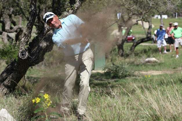 Fred Couples works his way out of the woods off the No. 7 fairway during the AT&T Championship at the TPC San Antonio, Sunday, Oct. 16, 2011. Couples won with a 23-under and took home the $270,000 prize money. JERRY LARA/glara@express-news.net Photo: JERRY LARA, Express-News / SAN ANTONIO EXPRESS-NEWS