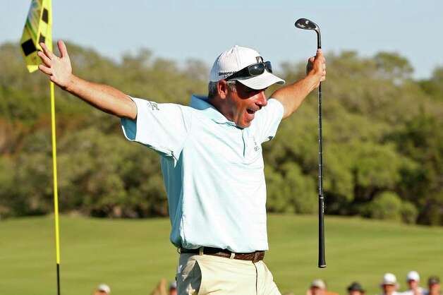Fred Couples celebrates his final chip shot for birdie on the 18th green during the Final Round of AT&T Championship at the TPC San Antonio, Sunday, Oct. 16, 2011. Couples won the tournament at 23-under and took home the $270,000 prize money. JERRY LARA/glara@express-news.net Photo: JERRY LARA, Express-News / SAN ANTONIO EXPRESS-NEWS