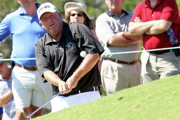 Mark Calcavecchia chips on to the No. 6 green during the AT&T Championship at the TPC San Antonio, Sunday, Oct. 16, 2011. Calcavecchia came in second with a score of 16-under.  JERRY LARA/glara@express-news.net Photo: JERRY LARA, Express-News / SAN ANTONIO EXPRESS-NEWS