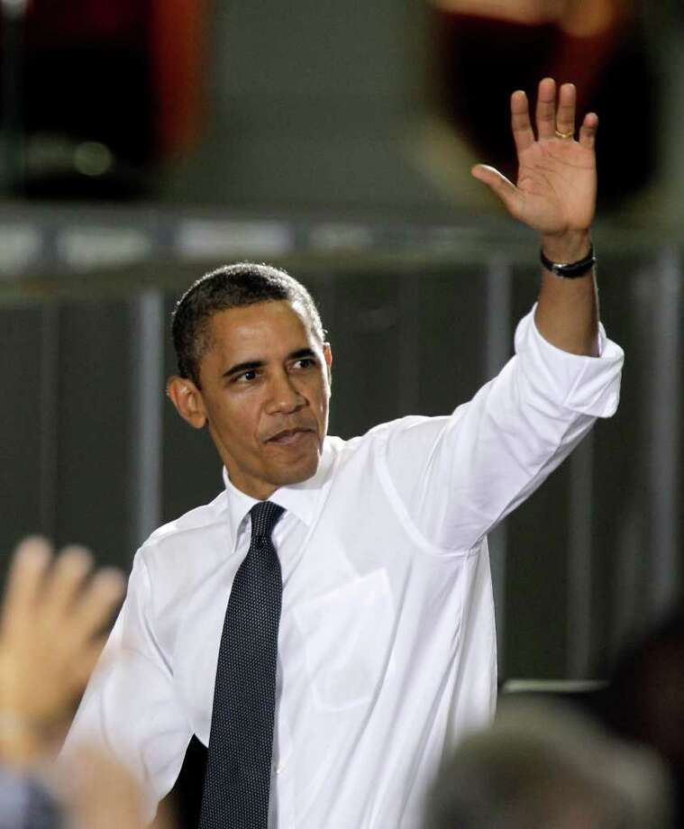 FILE - In this Oct. 14, 2011 file photo, President Barack Obama waves after speaking at the General Motors Orion assembly plant with South Korean President Lee Myung-bak in Orion Township, Mich., to promote a new trade deal between the two countries. Obama has shored up support from mid-level donors in some of the most economically distraught areas of the country, even as his Republican challengers have made jobs a central issue heading into next year's election. (AP Photo/Carlos Osorio, File) Photo: Carlos Osorio