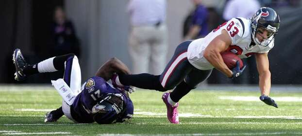 Houston Texans wide receiver Kevin Walter (83) is tackled by Baltimore Ravens cornerback Lardarius Webb (21) during the first quarter of an NFL football game at M&T Bank Stadium Sunday, Oct. 16, 2011, in Baltimore. Photo: Brett Coomer, Houston Chronicle / © 2011  Houston Chronicle