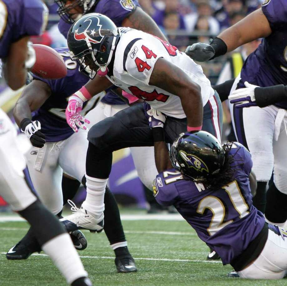 Houston Texans running back Ben Tate (44) fumbles as he is hit by Baltimore Ravens cornerback Lardarius Webb (21) during the second quarter of an NFL football game at M&T Bank Stadium Sunday, Oct. 16, 2011, in Baltimore. Photo: Brett Coomer, Houston Chronicle / © 2011  Houston Chronicle