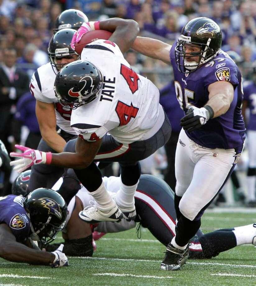 Houston Texans running back Ben Tate (44) is taken down by Baltimore Ravens outside linebacker Jarret Johnson (95) during the second quarter of an NFL football game at M&T Bank Stadium Sunday, Oct. 16, 2011, in Baltimore. Photo: Brett Coomer, Houston Chronicle / © 2011  Houston Chronicle