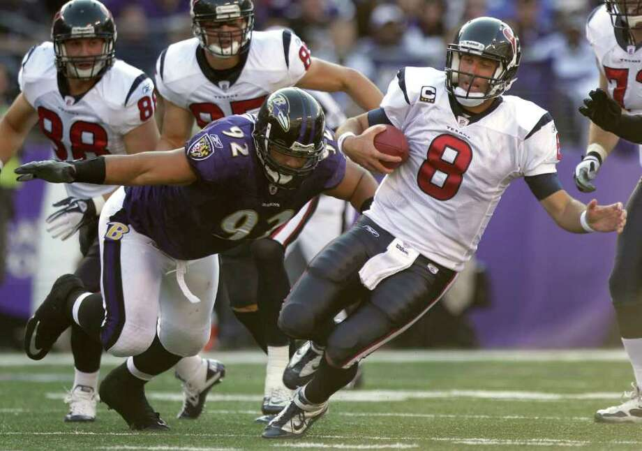 Houston Texans quarterback Matt Schaub (8) is forced out of the pocket by Baltimore Ravens defensive end Haloti Ngata (92) during the second quarter of an NFL football game at M&T Bank Stadium Sunday, Oct. 16, 2011, in Baltimore. Photo: Brett Coomer, Houston Chronicle / © 2011  Houston Chronicle