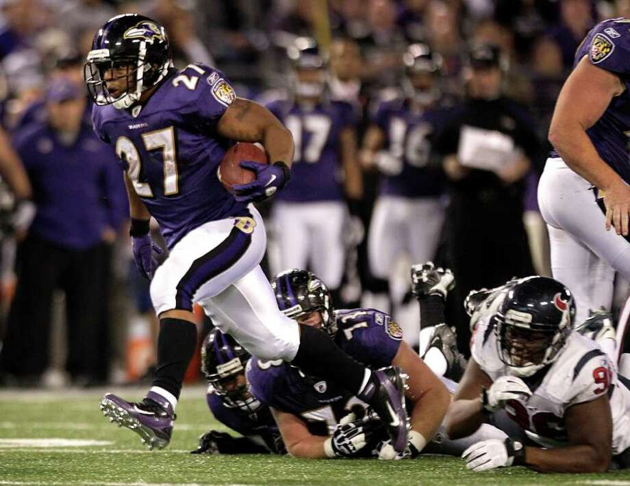 Baltimore Ravens running back Ray Rice (27) breaks away from Houston Texans defensive end Tim Jamison (96) during the fourth quarter of an NFL football game at M&T Bank Stadium Sunday, Oct. 16, 2011, in Baltimore. Photo: Brett Coomer, Houston Chronicle / © 2011  Houston Chronicle