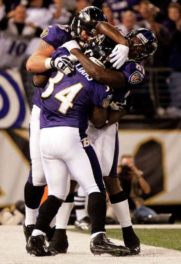 Baltimore Ravens running back Ricky Williams (34) celebrates his 4-yard touchdown run against the Houston Texans during the fourth quarter of an NFL football game at M&T Bank Stadium Sunday, Oct. 16, 2011, in Baltimore. Photo: Brett Coomer, Houston Chronicle / © 2011  Houston Chronicle