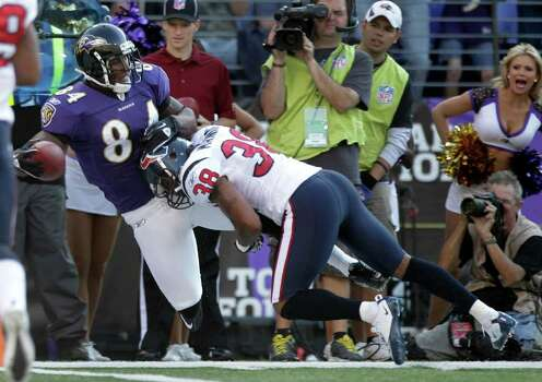 Baltimore Ravens tight end Ed Dickson (84) is tackled by Houston Texans free safety Danieal Manning (38) as he makes a first down reception during the first quarter of an NFL football game at M&T Bank Stadium Sunday, Oct. 16, 2011, in Baltimore. Photo: Brett Coomer, Houston Chronicle / © 2011  Houston Chronicle