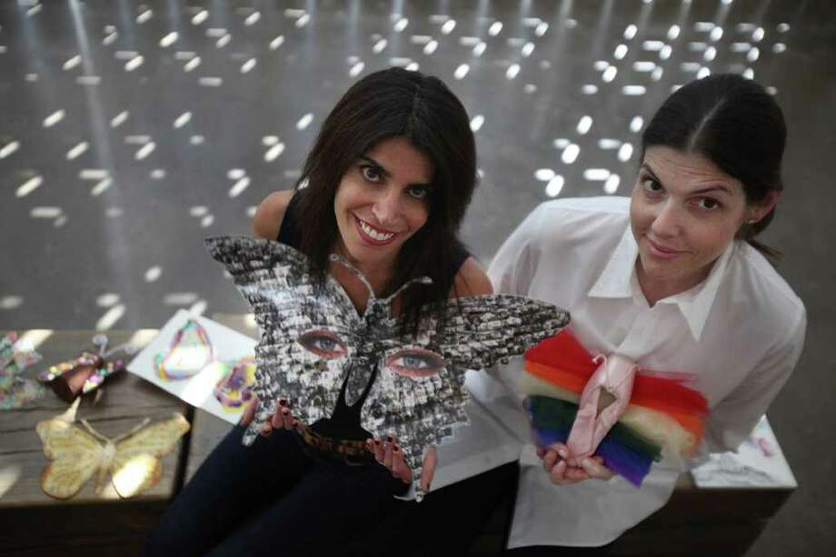 Erica Levit and Patti Kagan, co-chairs of the 2012 Butterfly Project Calendar, show butterflies submitted for the calendar at The Holocaust Museum Houston. Photo: Mayra Beltran / © 2011 Houston Chronicle