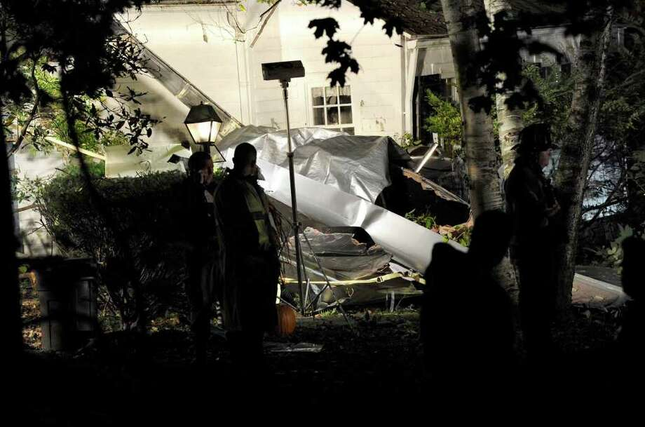The scene of a plane crash off Wooster Heights Road in Danbury Sunday night. Photo taken Oct. 16, 2011. Photo: Carol Kaliff
