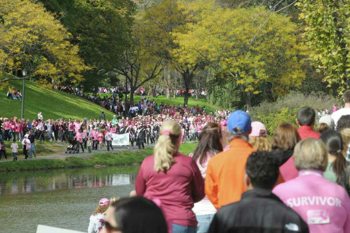 Walkers make their way around the lake during the Making Strides Against Breast Cancer event at Washington Park on Sunday, Oct. 16, 2011 in Albany. (Paul Buckowski / Times Union)