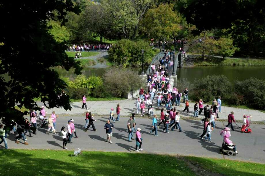 Walkers make their way around the lake during the  Making Strides Against Breast Cancer event at Washington Park on Sunday, Oct. 16, 2011 in Albany.  (Paul Buckowski / Times Union) Photo: Paul Buckowski / 00014956A