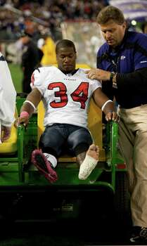 Houston Texans defensive back Dominique Barber (34) sits on a cart after suffering an injury against the Baltimore Ravens during the fourth quarter of an NFL football game at M&T Bank Stadium Sunday, Oct. 16, 2011, in Baltimore. Photo: Brett Coomer, Houston Chronicle / © 2011  Houston Chronicle