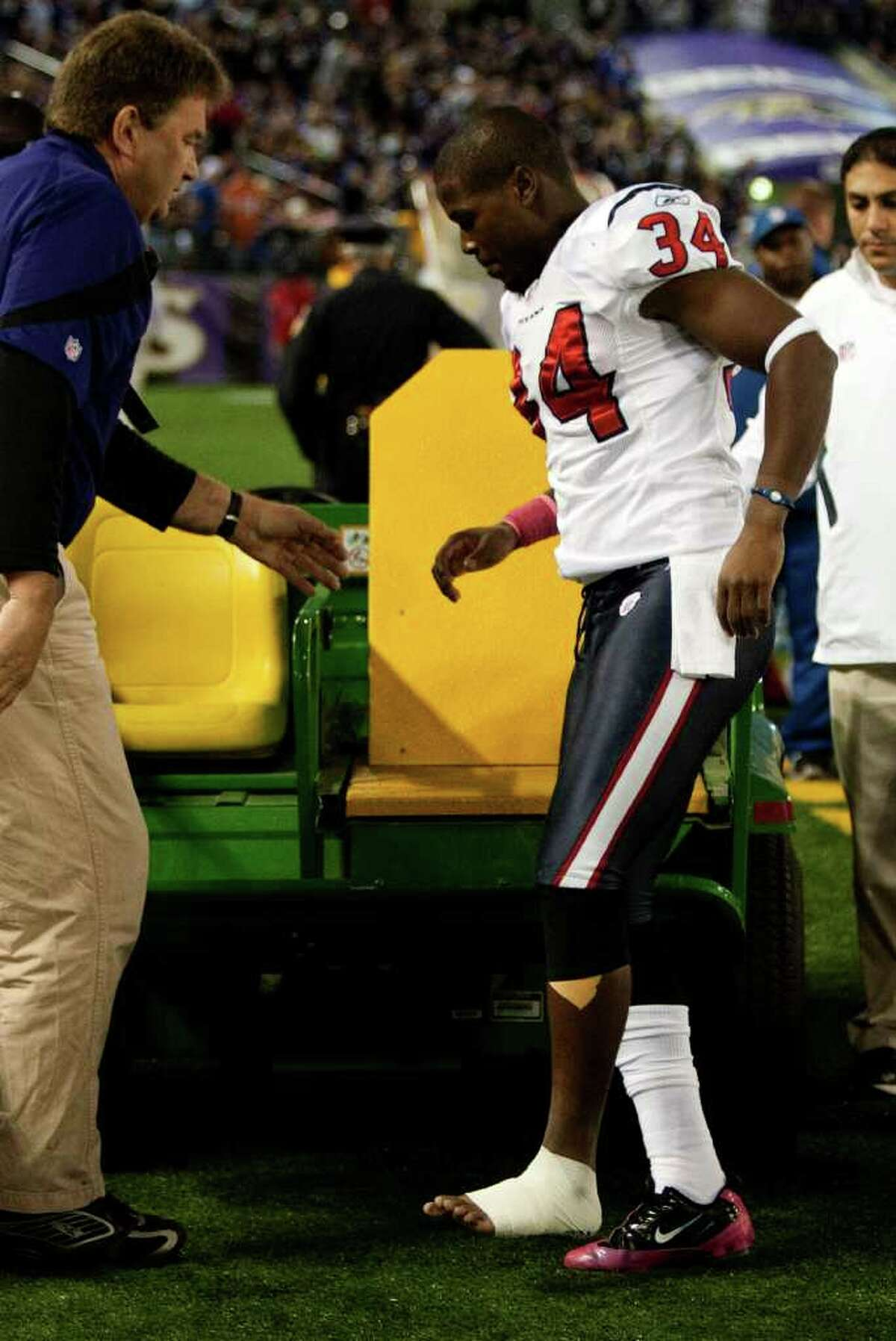 Houston Texans defensive back Dominique Barber (34) limps a cart after suffering an injury against the Baltimore Ravens during the fourth quarter of an NFL football game at M&T Bank Stadium Sunday, Oct. 16, 2011, in Baltimore.