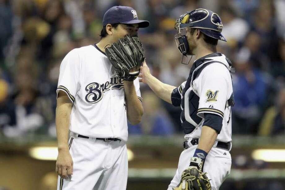 MILWAUKEE, WI - OCTOBER 16:  (L-R) Takashi Saito #40 and Jonathan Lucroy #20 of the Milwaukee Brewers talk on the mound against the St. Louis Cardinals during Game Six of the National League Championship Series at Miller Park on October 16, 2011 in Milwaukee, Wisconsin. Photo: Christian Petersen, Getty / 2011 Getty Images