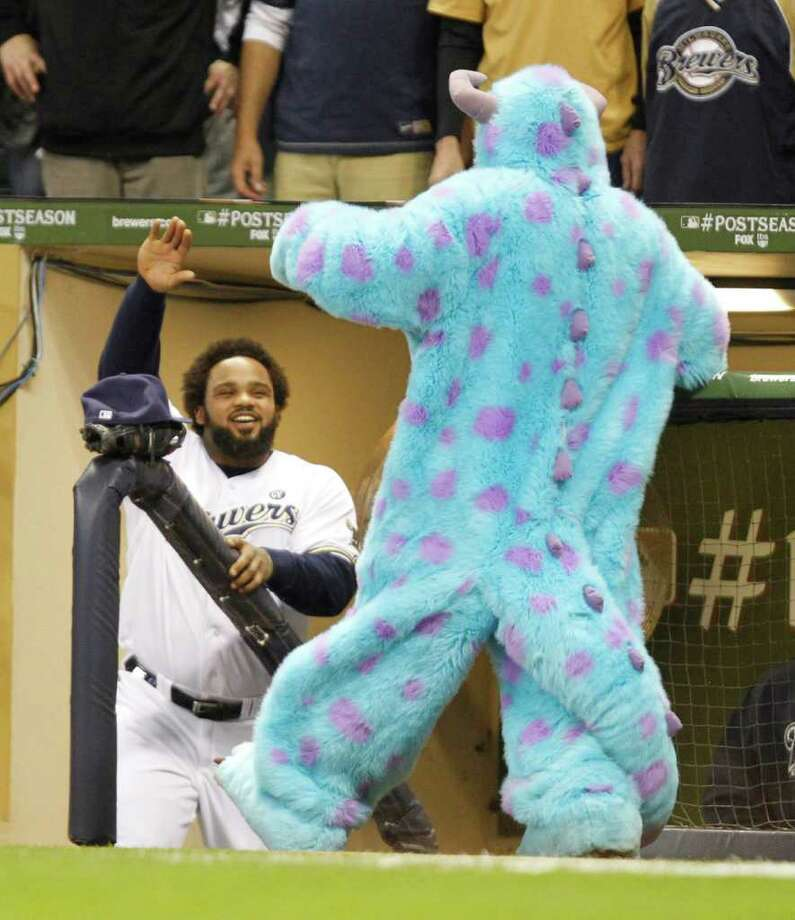 Milwaukee Brewers Prince Fielder gets a high five from Sully of Monsters Inc before the start of Game 6 of the National League Championship Series against the St. Louis Cardinals in Milwaukee, Wisconsin, Sunday, October 16, 2011. (Rick Wood/Milwaukee Journal Sentinel/MCT) Photo: Rick Wood, McClatchy-Tribune News Service / Milwaukee Journal Sentinel