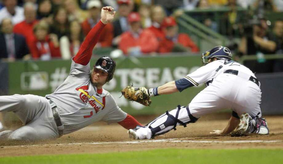 St. Louis' Matt Holliday scores on a sacrifice fly by Nick Punto in the third inning against the Milwaukee Brewers during Game 6 of the National League Championship Series in Milwaukee, Wisconsin, Sunday, October 16, 2011.  Photo: Tom Lynn, McClatchy-Tribune News Service / Milwaukee Journal Sentinel