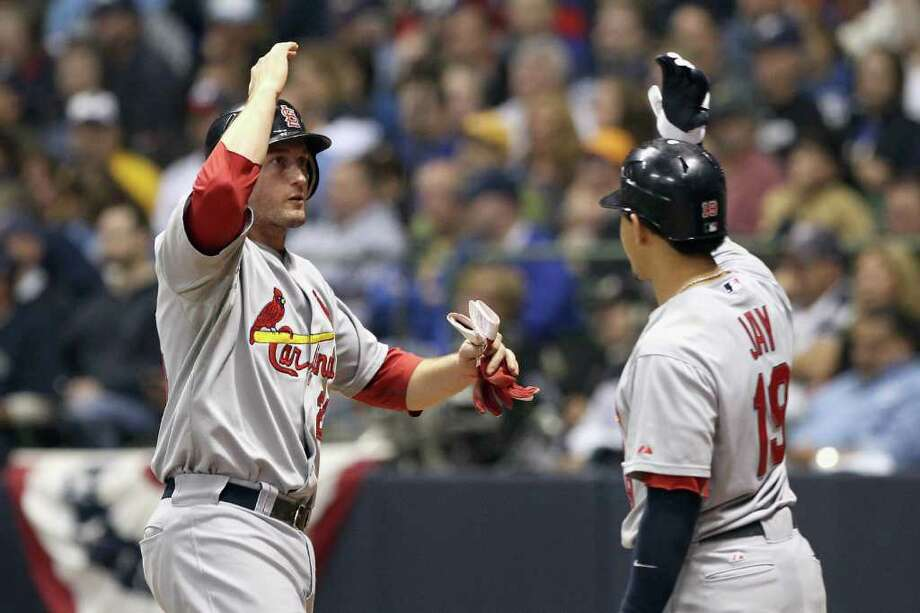 MILWAUKEE, WI - OCTOBER 16:  David Freese #23 of the St. Louis Cardinals celebrates with Jon Jay #19 after Freese scored in the top of the fifth inning against the Milwaukee Brewers during Game Six of the National League Championship Series at Miller Park on October 16, 2011 in Milwaukee, Wisconsin. Photo: Christian Petersen, Getty / 2011 Getty Images